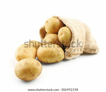 Young potatoes in sackcloth bag isolated on white - stock photo