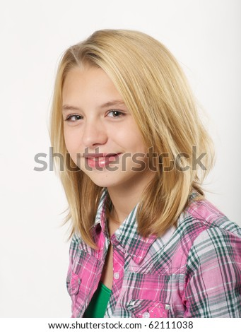 Young, Pre-teen girl smiling in studio over white background. - stock photo