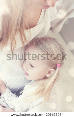Young pregnant woman with her little daughter