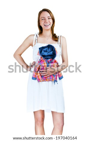 Young pregnant woman with kids clothing over her belly