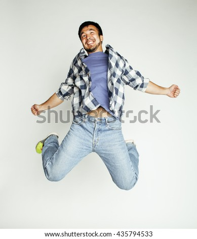 young pretty asian man jumping cheerful against white background, lifestyle people concept