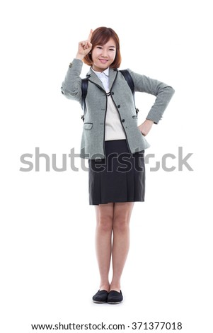 Young pretty Asian student indicate up space, isolated on white background.  - stock photo