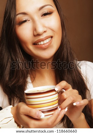 young pretty asian woman drinking coffee