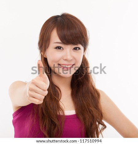Young pretty Asian woman showing thumb isolated on white background. - stock photo