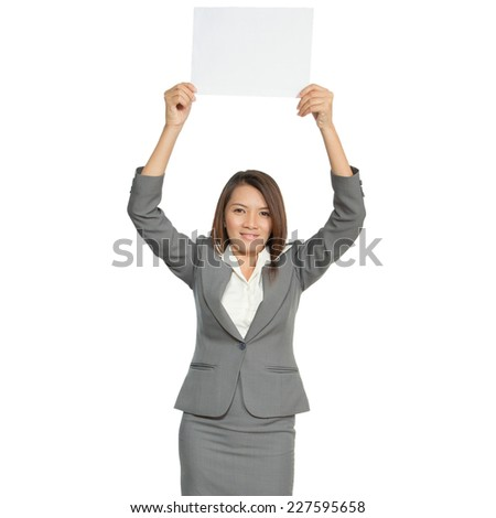Young pretty attractive brunette Asian businesswoman standing positive showing blank signboard smiling, isolated on white background - stock photo