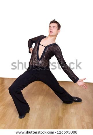 Young pretty ballroom dancer dancing on parquet - stock photo
