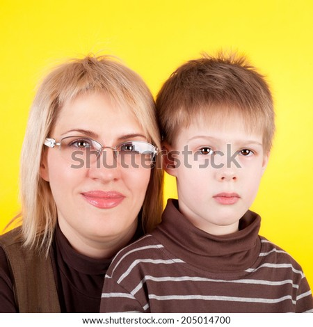 young pretty blond mother with her cute little son - stock photo