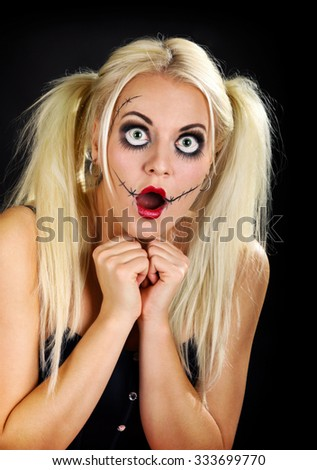 young pretty blond woman in a halloween outfit - stock photo