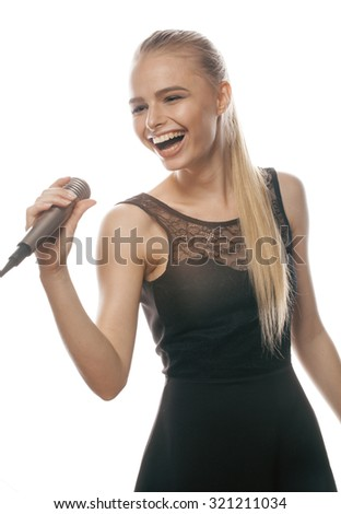 young pretty blond woman singing in microphone isolated close up karaoke