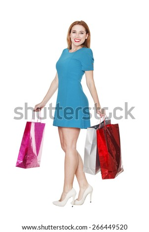 Young pretty blonde woman makes shopping