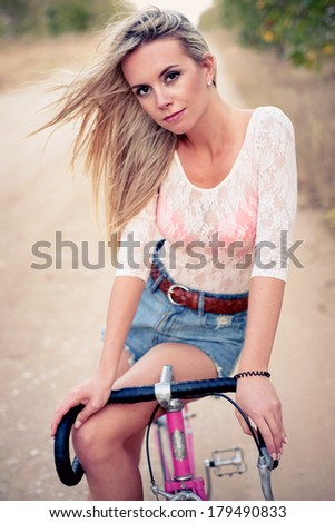 Young pretty blonde woman posing  in summer sunshine. Fashion portrait.