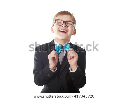 Young pretty boy posing at studio as a fashion model. Photo of preschooler 9 years old isolated on over white background  - stock photo