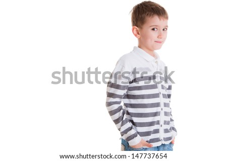Young pretty boy posing at studio as a fashion model. Photo of preschooler 6 years old over white background - stock photo