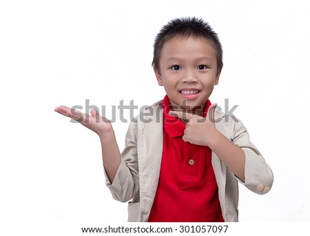 Young pretty boy posing at studio as a fashion model white background,Asian little boy giving you thumbs up