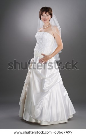young pretty bride wearing wedding gown - stock photo