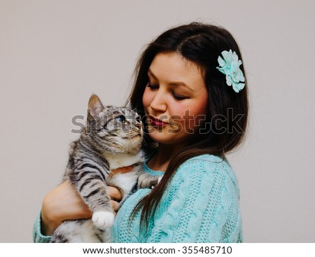 Young pretty brunette girl and her cat