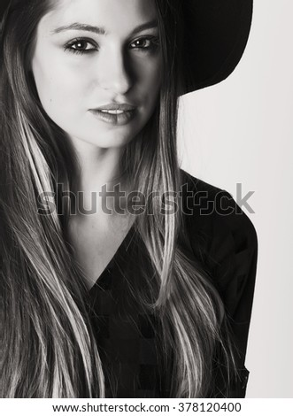 young pretty brunette girl hipster in hat on white background casual close up dreaming smiling. real american woman