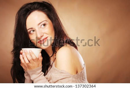 young pretty brunette  woman drinking coffee