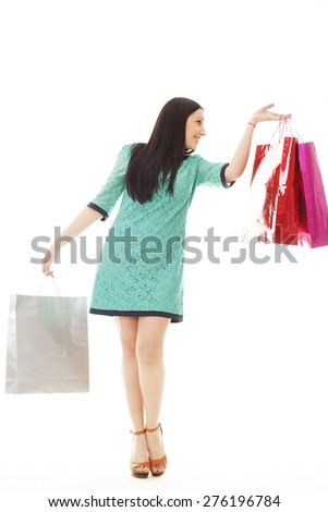 Young pretty brunette woman makes shopping - stock photo