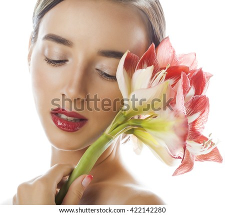 young pretty brunette woman with red flower amaryllis close up isolated on white background. Fancy fashion makeup, bright lipstick, creative Ombre manicured nails. spa skin care - stock photo