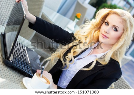 Young pretty business woman with notebook - stock photo