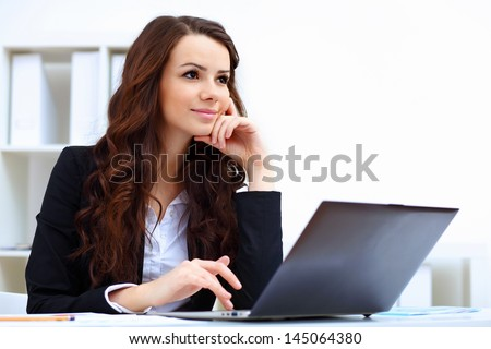 Young pretty business woman with notebook in the office - stock photo