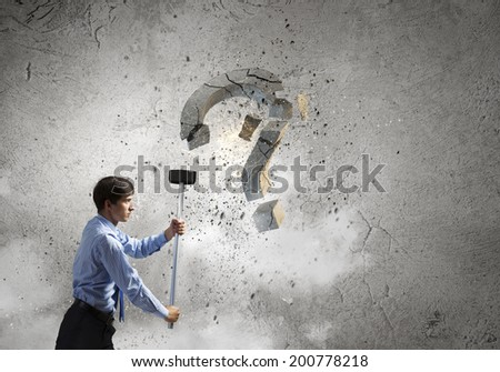 Young pretty businessman crashing stone question symbol - stock photo