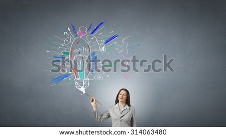 Young pretty businesswoman holding paint brush. Creativity concept
