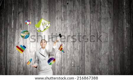 Young pretty businesswoman juggling with white balls. Elements of this image are furnished by NASA - stock photo