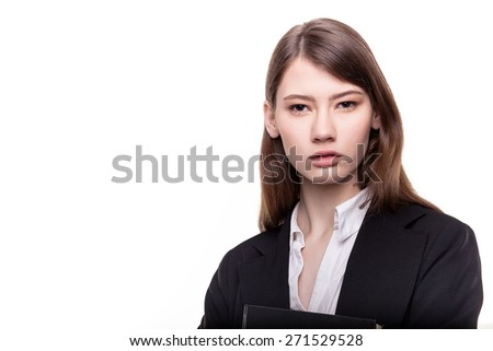 Young pretty businesswoman or student in suit stock image - stock photo