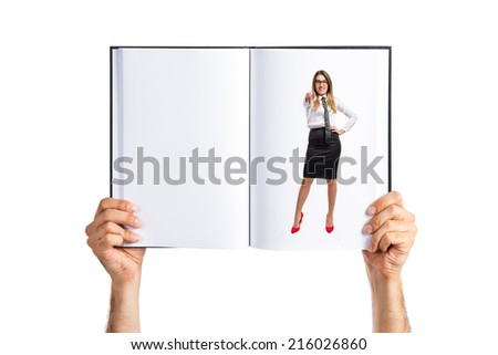 Young pretty businesswoman pointing printed on book - stock photo