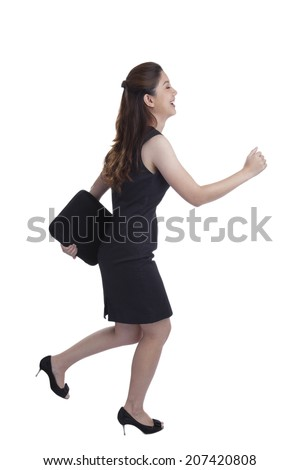 Young Pretty Businesswoman running in suit in full body isolated on white background. Business concept image with young mixed race Caucasian / Chinese Asian businesswoman. - stock photo