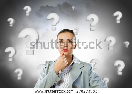 Young pretty businesswoman with question mark over head