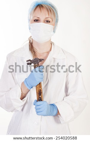Young pretty doctor with hammer