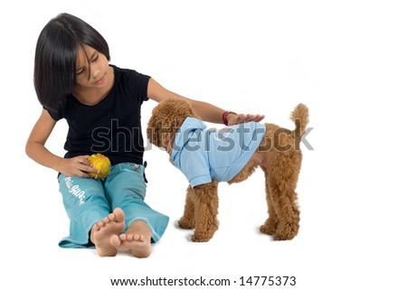 Young pretty Eurasian Chinese girl petting a small dog