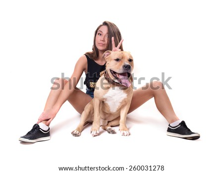 young pretty fashion woman with red staffordshire terrier - stock photo