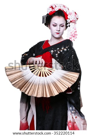 young pretty geisha in kimono with sakura and decoration. Portrait of a Japanese geisha woman isolated on white - stock photo