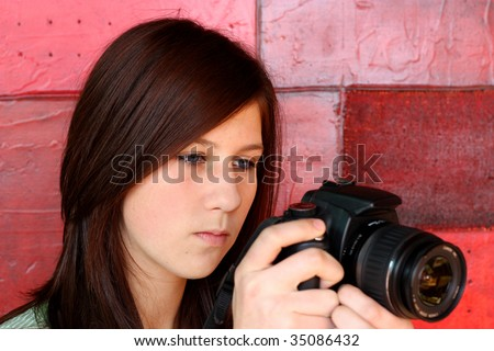 Young pretty girl about to take a photograph - stock photo
