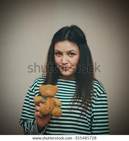 Young pretty girl and her teddy bear - stock photo