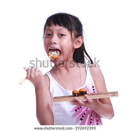 Young pretty girl eating sushi with sticks isolated on white background - stock photo