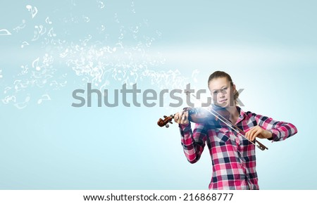 Young pretty girl in casual playing violin