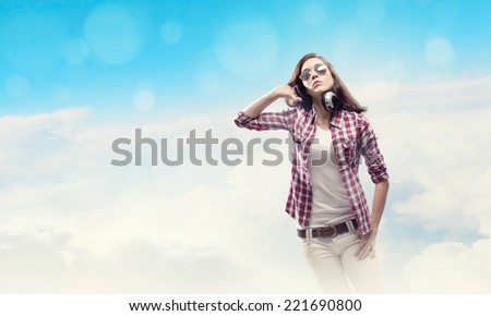 Young pretty girl in casual wearing headphones