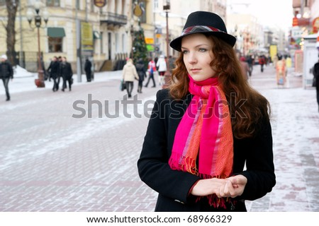 Young pretty girl in winter city