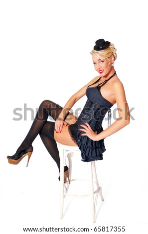 young pretty girl is sit on the chair and flirt - stock photo