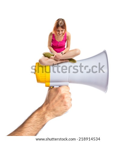 Young pretty girl looking down on megaphone - stock photo