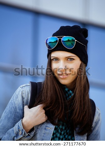 young pretty girl near business building walking, student in america or europe close up - stock photo