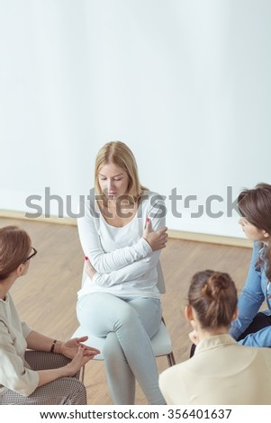 Young pretty girl on support group meeting