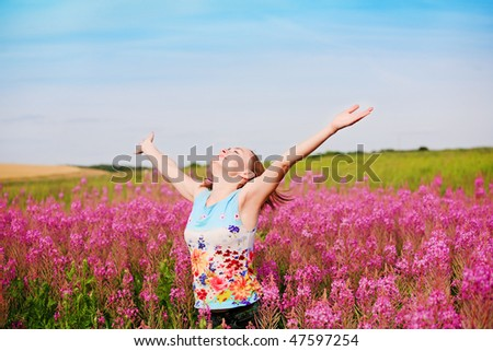 Young pretty girl on the field - stock photo