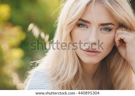 Young pretty girl outdoor. freckles woman portrait. blonde cheerful woman  - stock photo