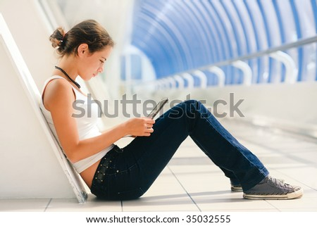Young pretty girl sitting with a laptop